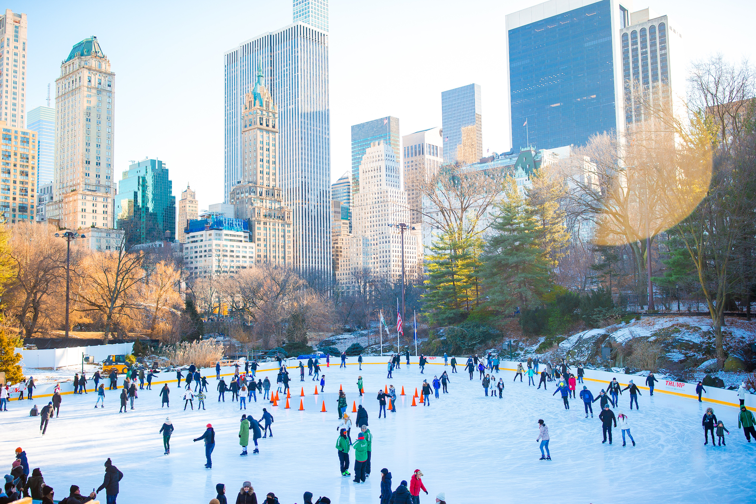 Ice skaters having fun in New York Central Park in winter